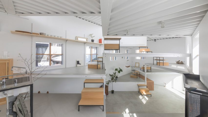 Platform floors function as tables and shelves inside House in Miyamoto