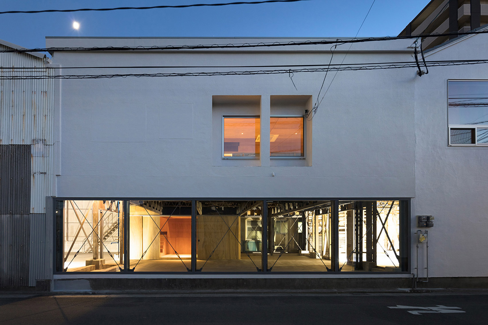 Schemata Architects adds sequence of plywood boxes to redefine spaces inside House in Nobeoka