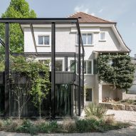 HHF Architects adds pergola-like extension to traditional Swiss villa