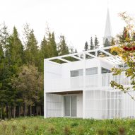 Atelier Pierre Thibault builds geometric white house in Quebec woods