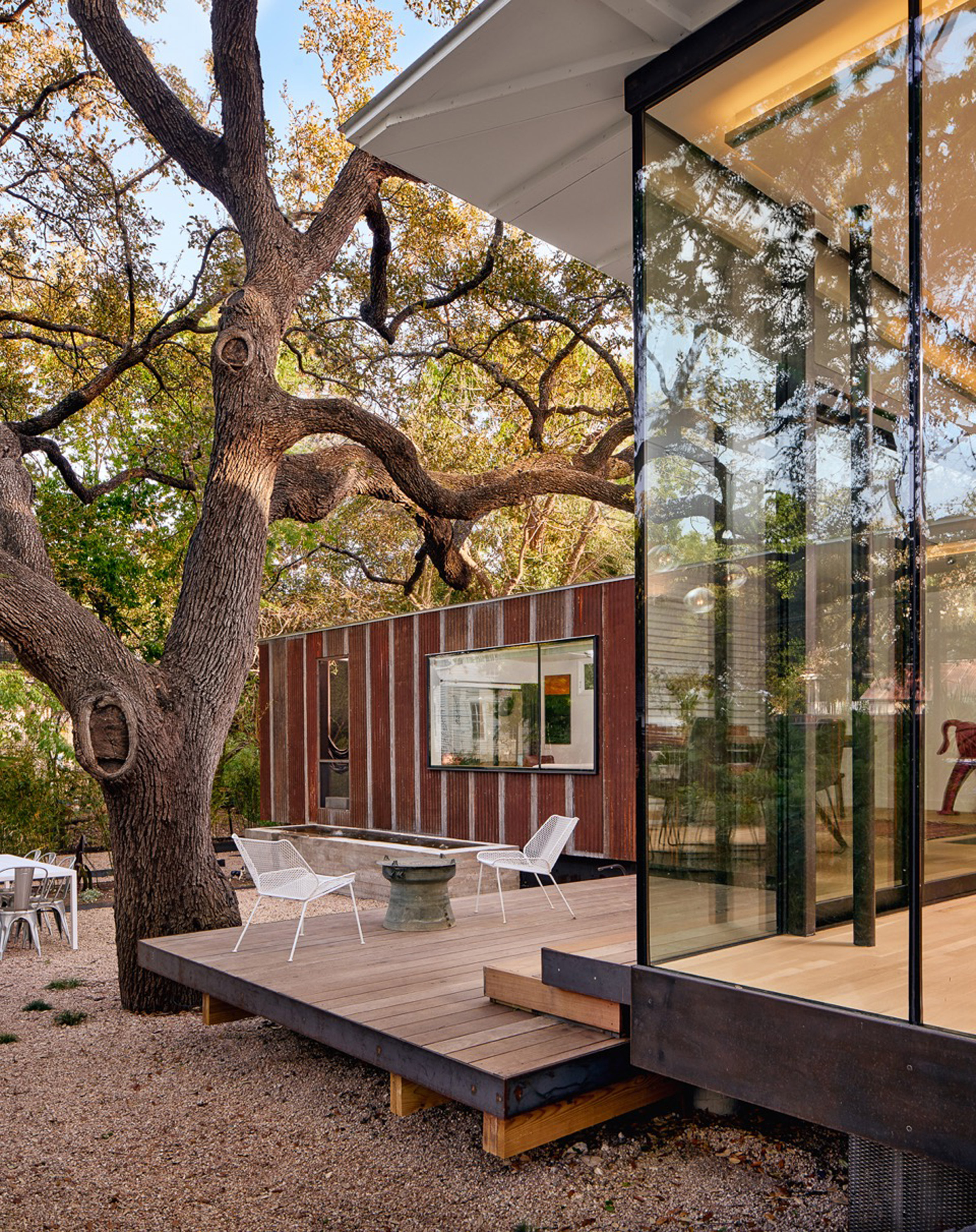 Nick Deaver enlarges 1930s cottage in Austin with glass and metal additions