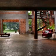 Brick-lined interiors open onto garden filled with fruit trees at The Mango House
