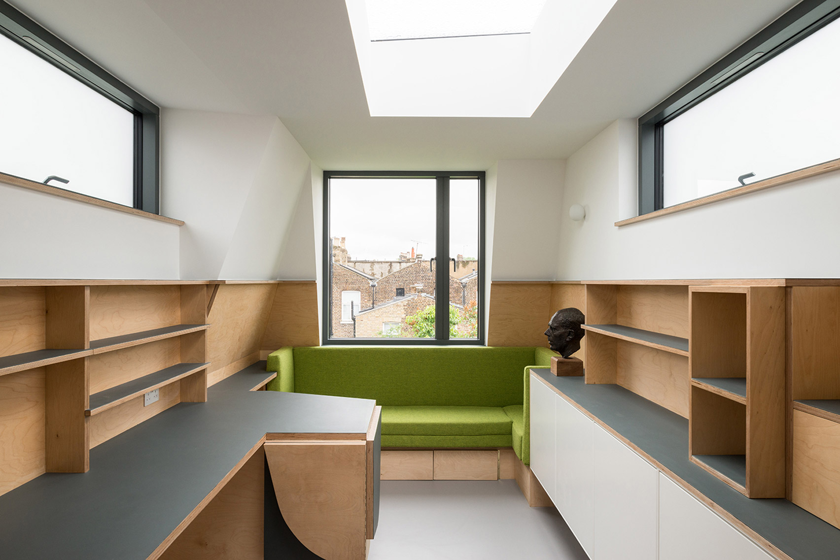 Canal boat interiors inspire space-efficient extension to London house by Archmongers