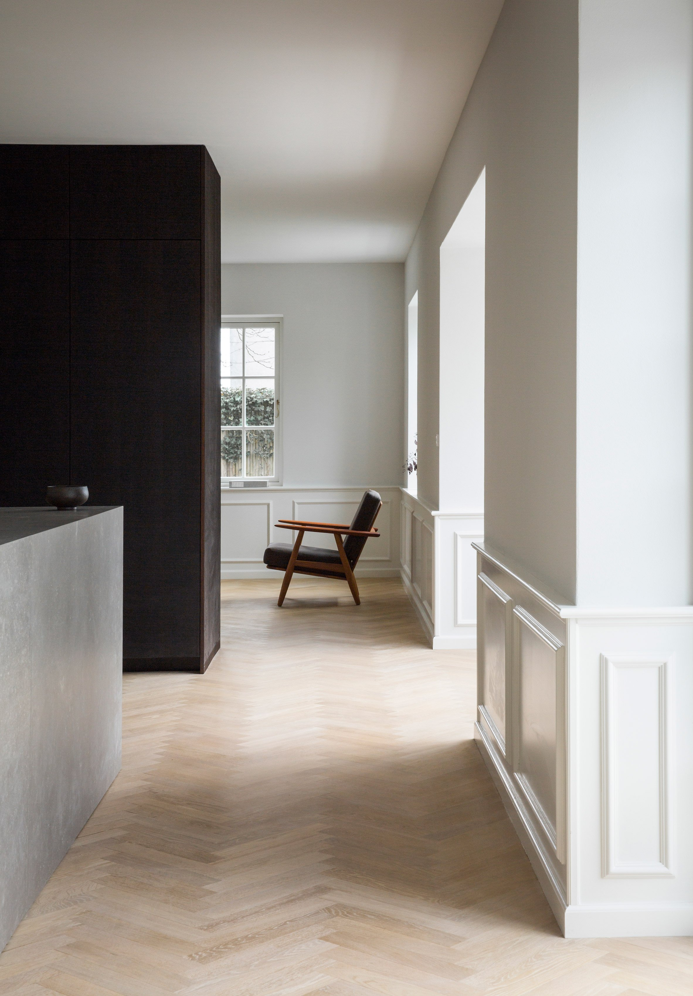 smoked oak and stone contrast with bright interiors of copenhagen home refurbished by norm. Black Bedroom Furniture Sets. Home Design Ideas