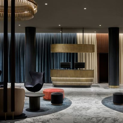 Space Copenhagen Renovates Landmark Arne Jacobsen Hotel Using Updated  Classic Furniture