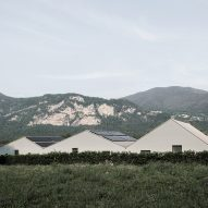 Swiss housing complex by Stocker Lee takes cues from mountainous landscape with zig-zag roof