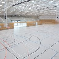 The sports hall designed by local architecture office Sporadical adjoins a recently modernised and extended primary school in the town of Dolní Břežany