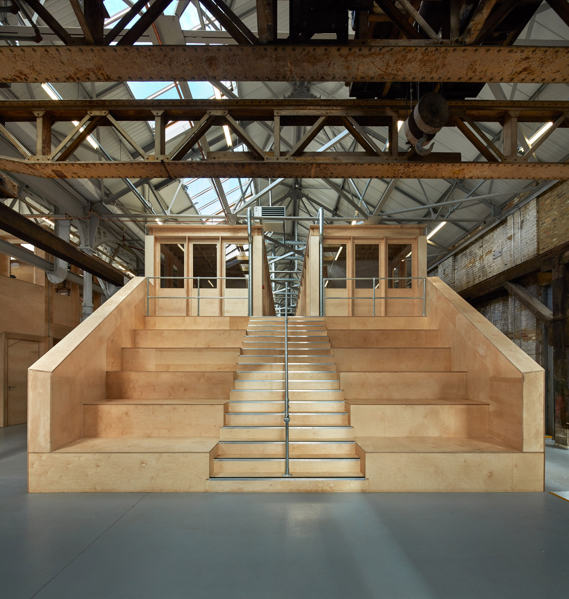 Emrys Architects uses timber inserts to convert east London ironworks into artists' studios