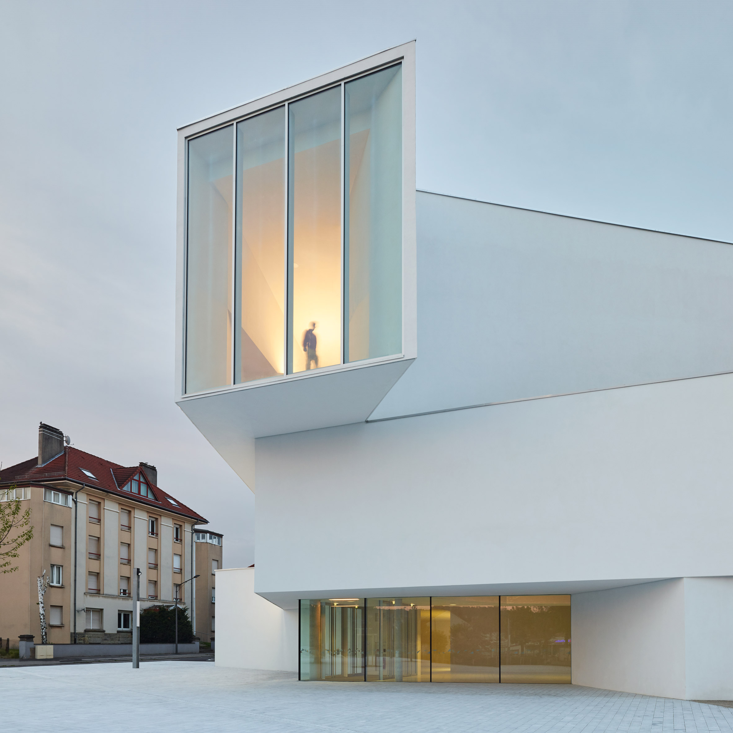 White Concrete Volumes Conceal Bright Red Auditorium In Dominique Coulon Associes Theatre