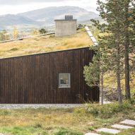 Bergersen Arkitekter's Viewpoint Granasjøen is an angular lakeside cabin with a turfed roof