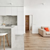 Raúl Sánchez Architects updates Barcelona flat with grey granite and bright white walls