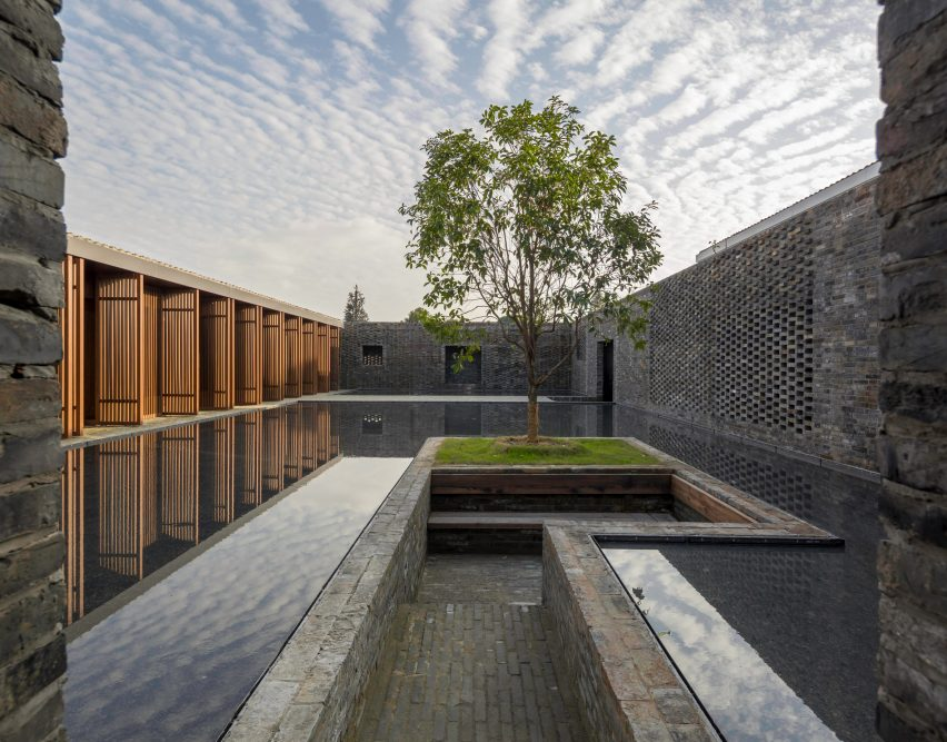 NeriHu encloses guest rooms and gardens within grid of brick walls