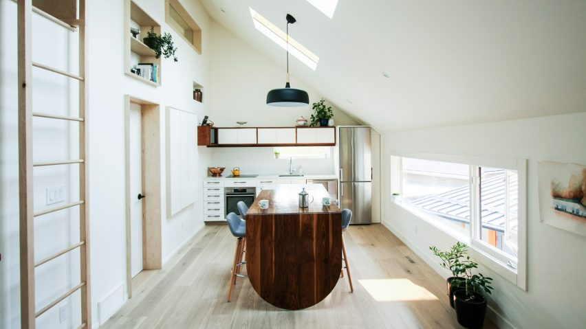 Dog nook and fireman\'s pole feature in laneway house by Studio North