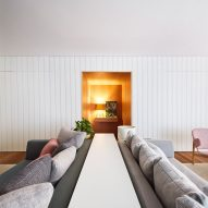 Grooved white panels divide São Paulo apartment by David Ito