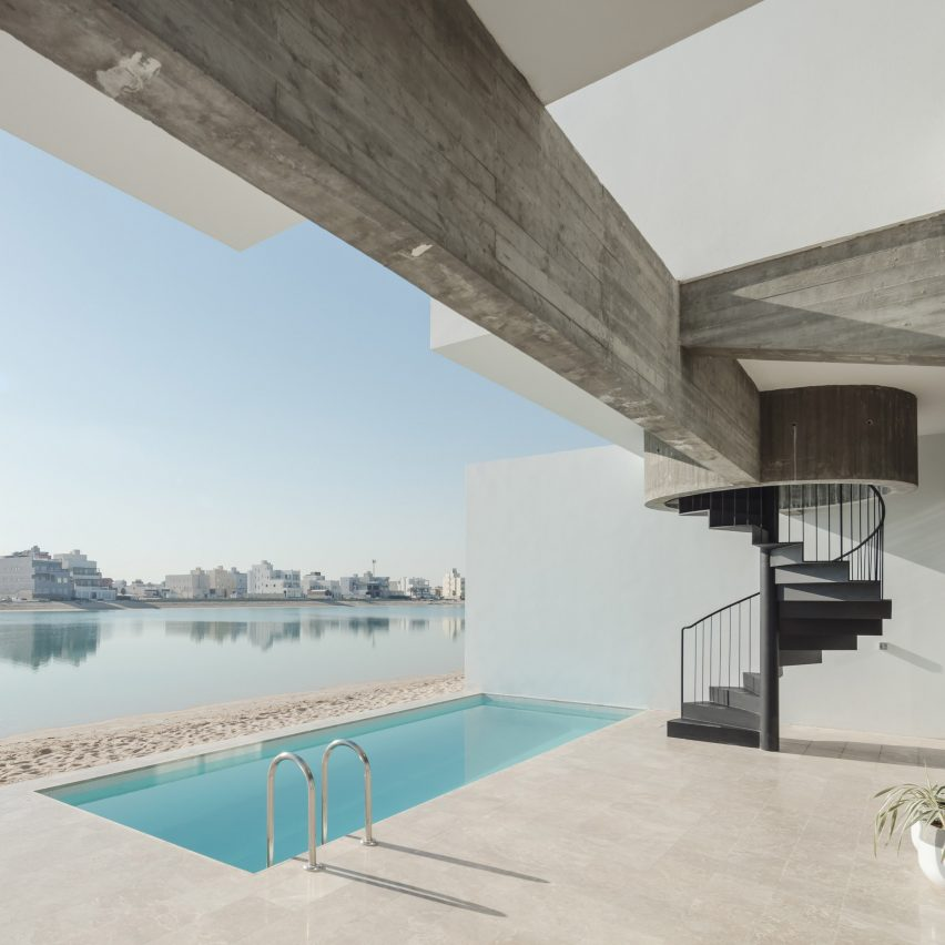 Open staircases ascend to rooftop terraces offering