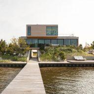 Pale cedar beach house by Raad Studio perches atop a sand dune