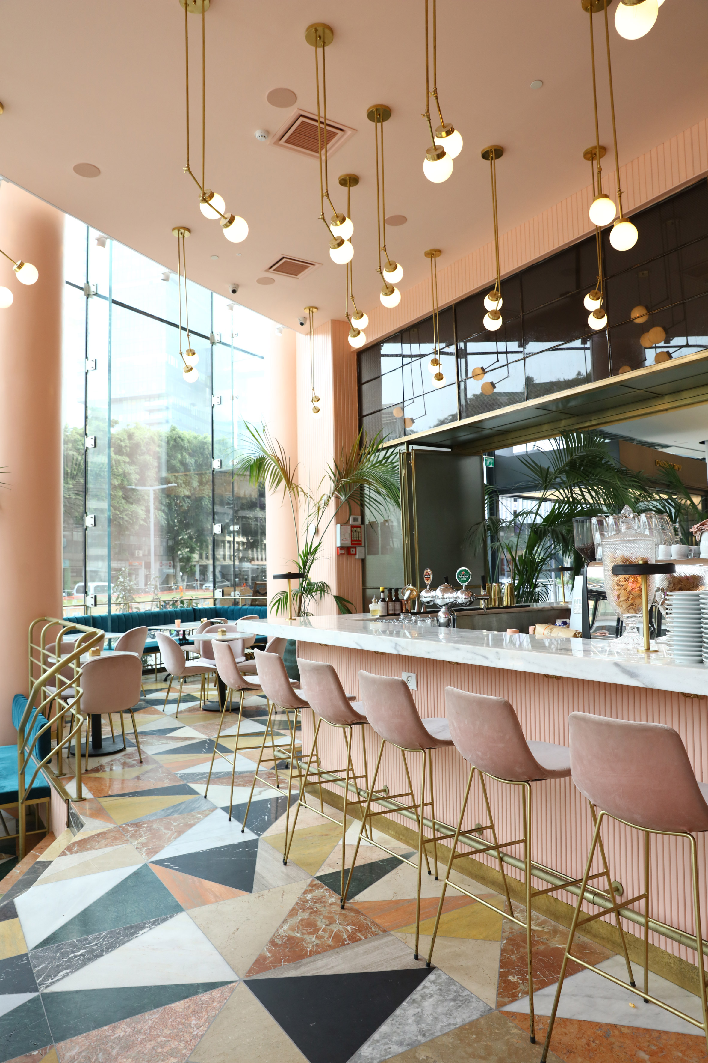 Pale pink and mismatched marble decorate Tel Aviv cafe by Meir Guri