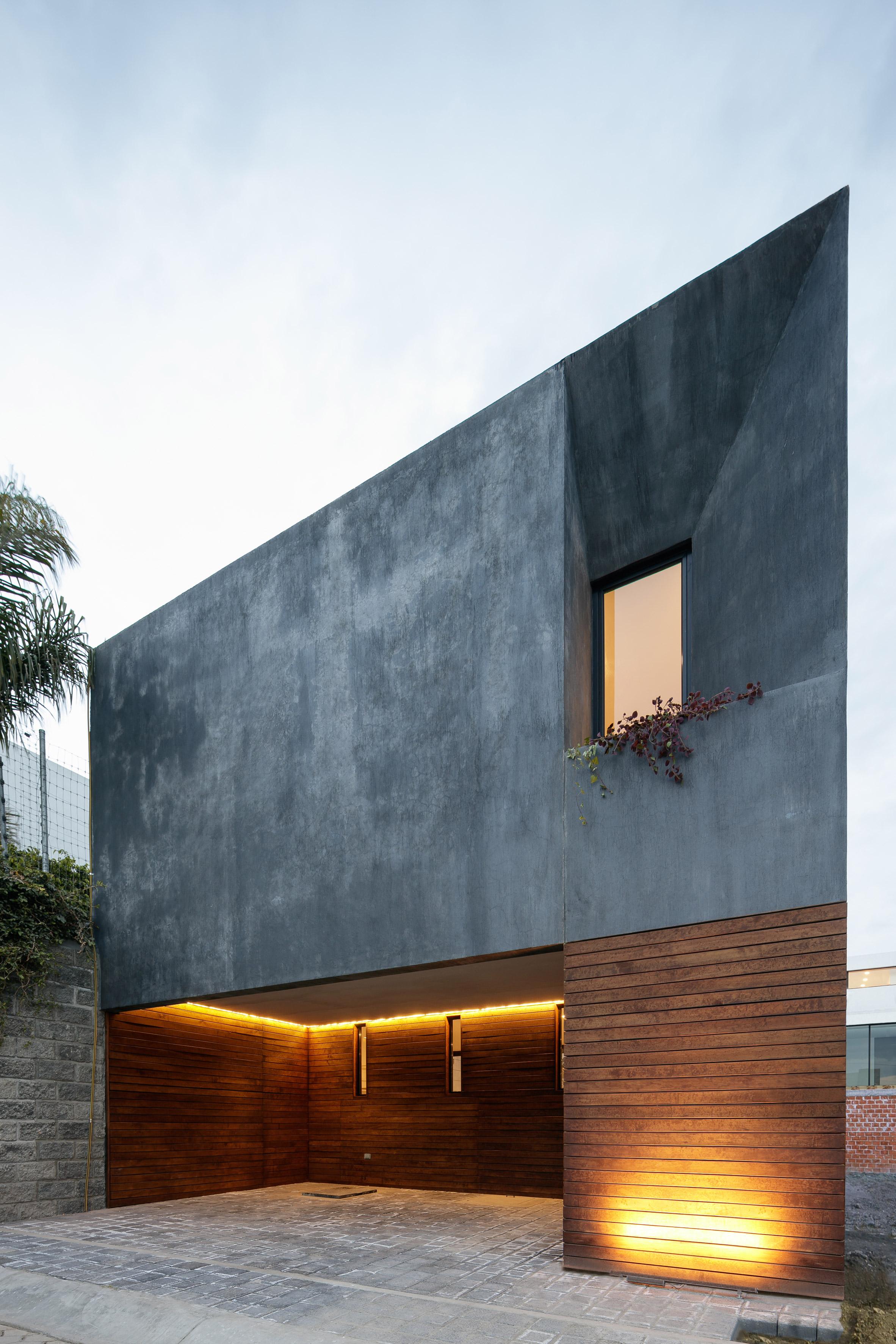 3novices espacio 18 squeezes grey townhouse onto tight for Espacio casa online