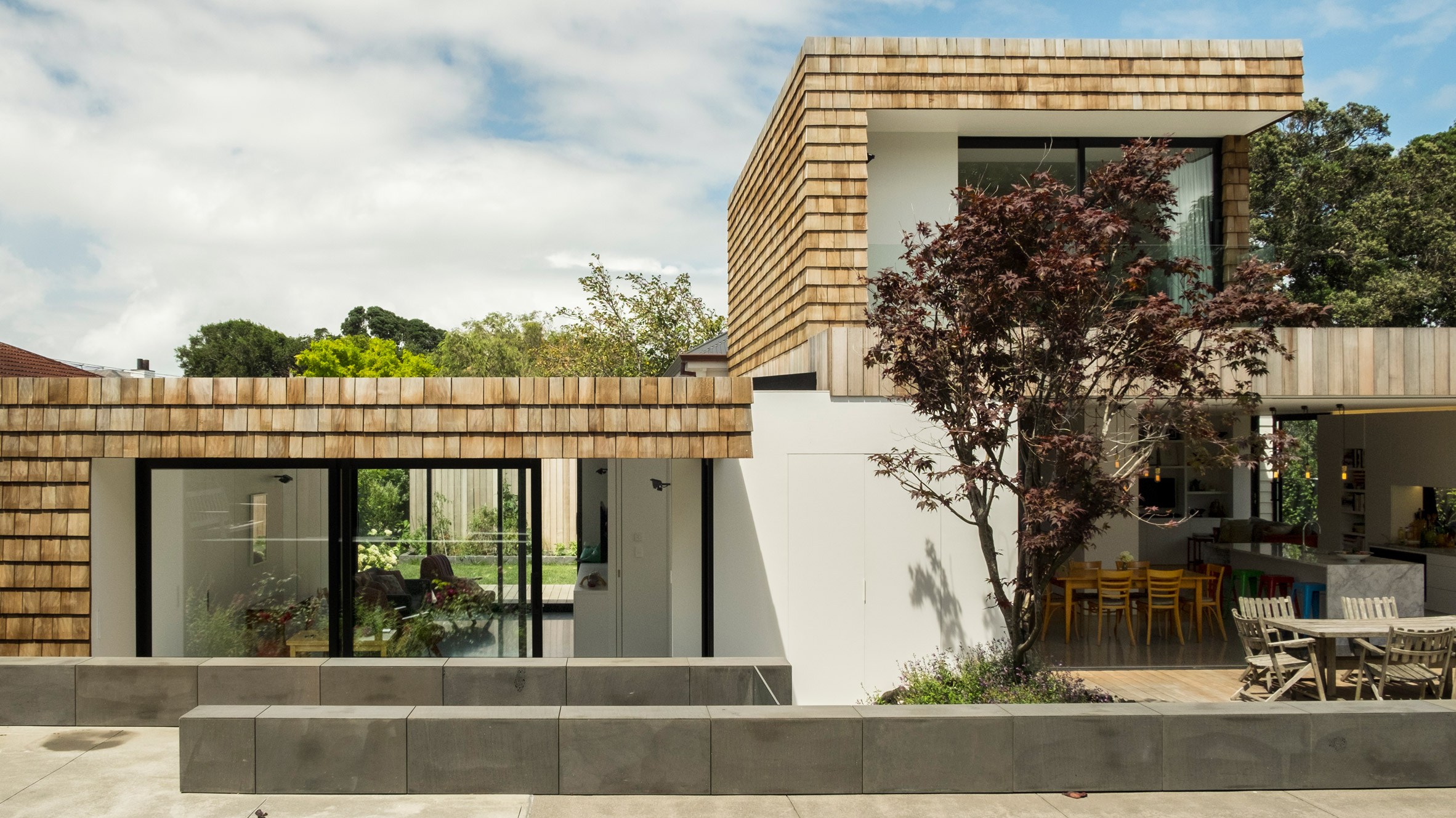 Gardens and terraces slot around timber extensions to