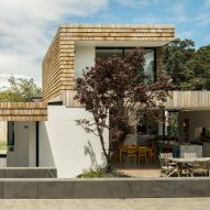 Gardens and terraces slot around timber-clad extensions to Auckland house