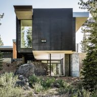 Creek House by Faulkner Architects preserves boulders on steep site in California