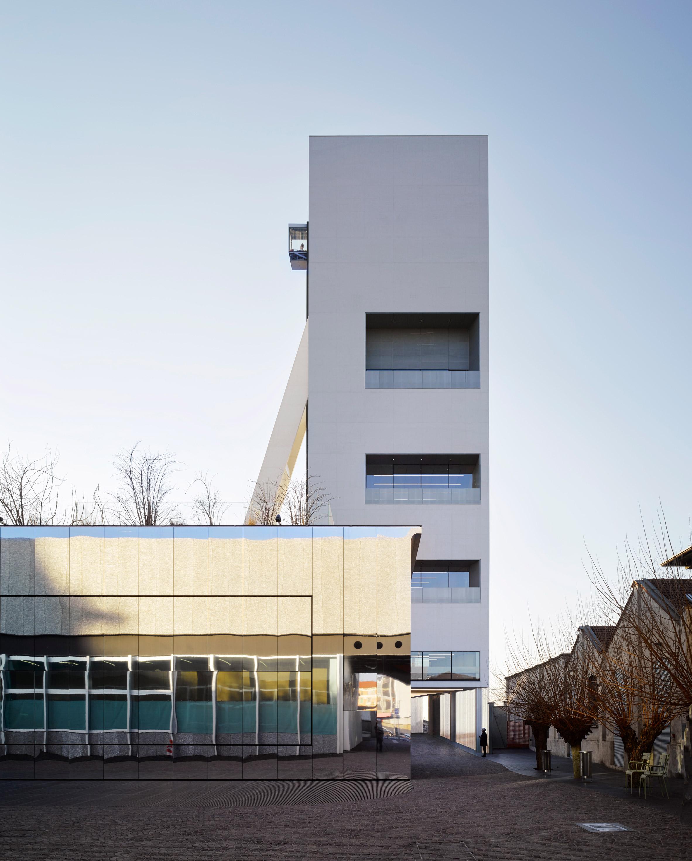 OMA adds white concrete gallery tower to Fondazione Prada art centre in Milan