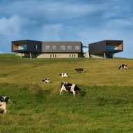 Coastal house by Atelier Andy Carson features cantilevered rooms looking out to sea