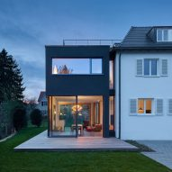 Holzer Architekten adds black extension to 1920s house in Stuttgart