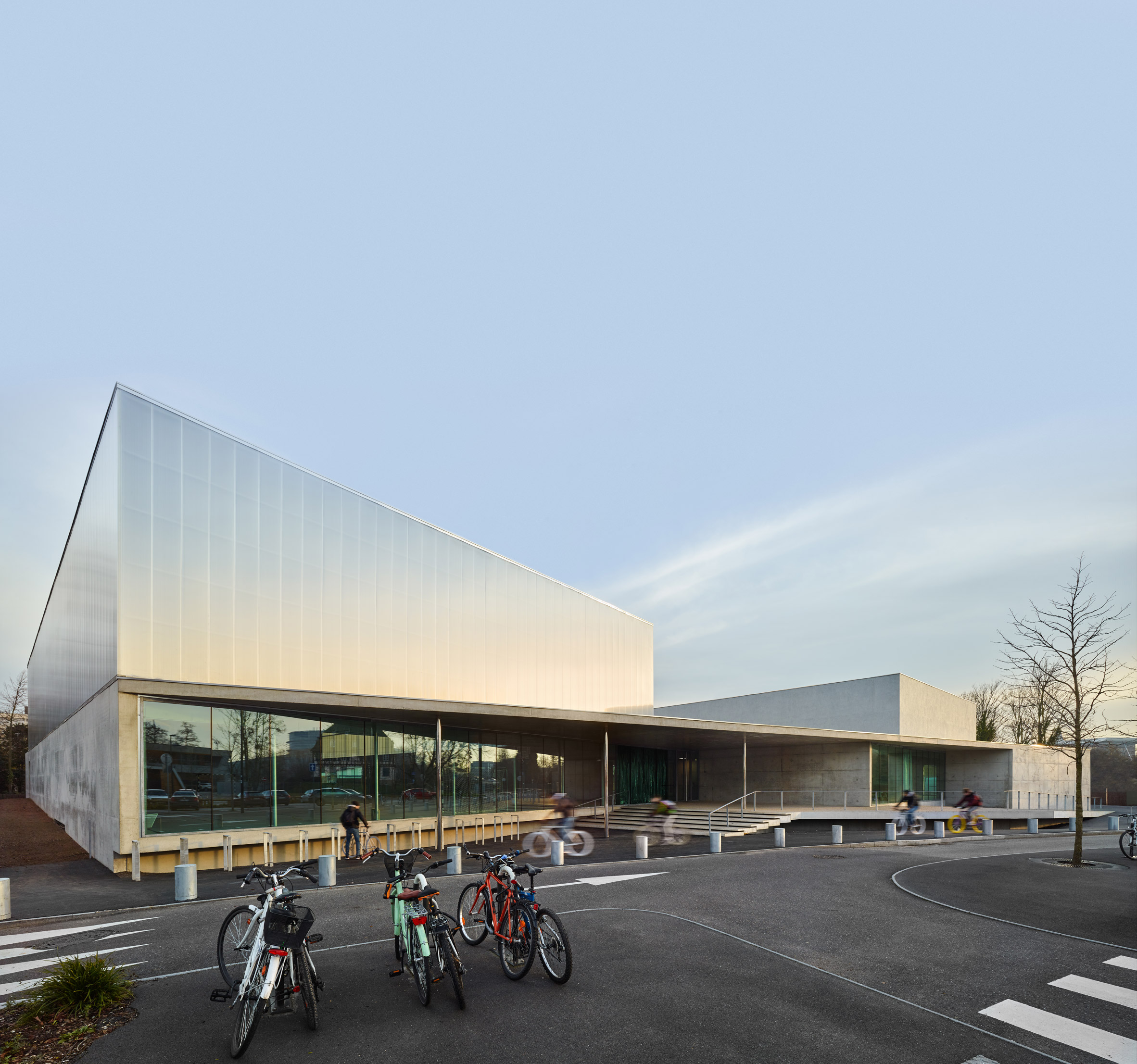 Glass walls create visual connection between Strasbourg sports hall and its surroundings