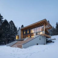 Quebec chalet by Bourgeois/Lechasseur steps down to a lake
