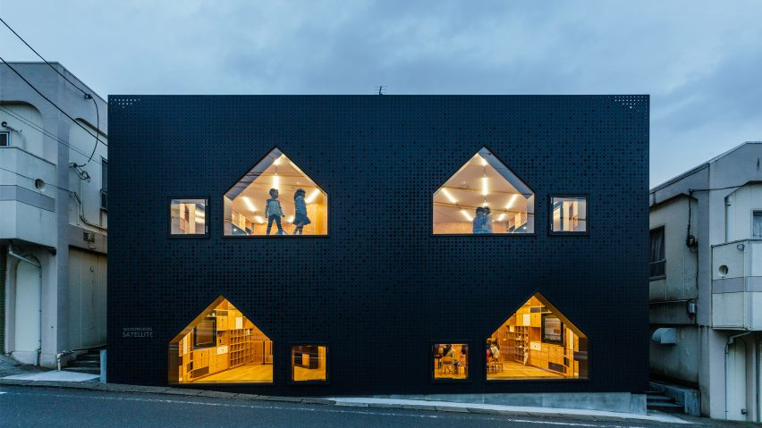 House-shaped windows puncture perforated-metal facades of Yokohama nursery