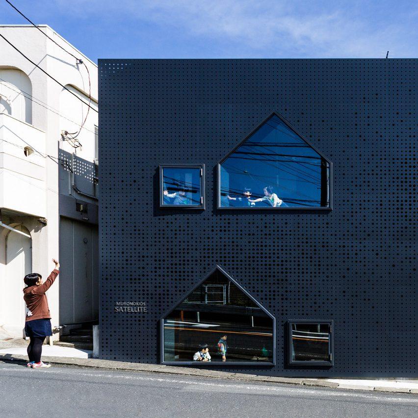 House-shaped windows puncture perforated-metal facades of Yokohama nursery