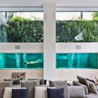 Swimming pool serves as centrepiece of São Paulo apartment by Fernanda Marques