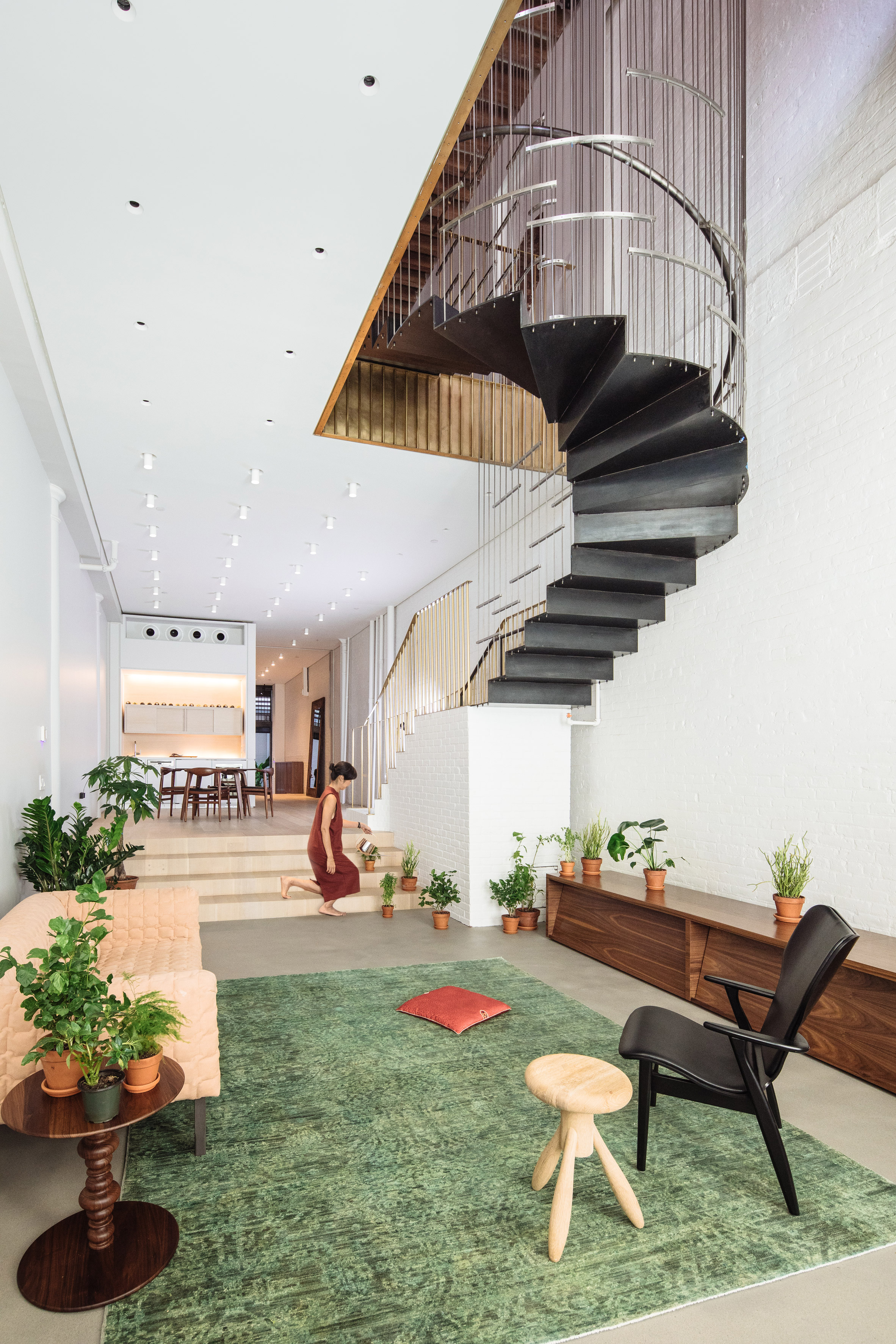 Dash Marshall merges two Tribeca lofts with sculptural staircase