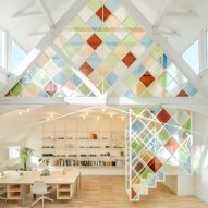 Stained glass dividers brighten London co-working space inside former church