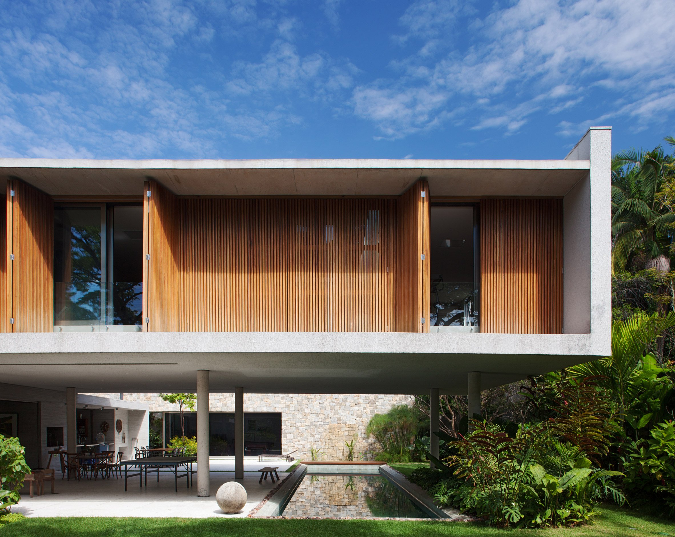 Perkins+Will places shuttered bedrooms atop pilotis at São Paulo house