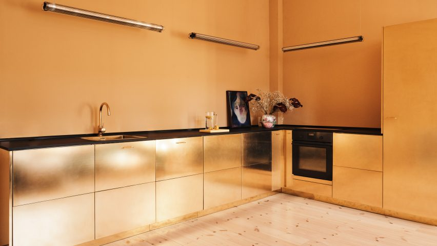 Reform Hacks IKEA Cabinets To Create Gold Hued Kitchen For Designer Stine  Goya