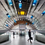 Grimshaw creates curved mirrored ceiling inside Toronto metro station