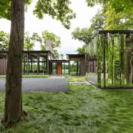 """Altus designs Minnesota home and accompanying """"shiny shed"""" to blend with the forest"""