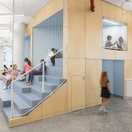A+I designs New York City school with colourful panels and tiered seating