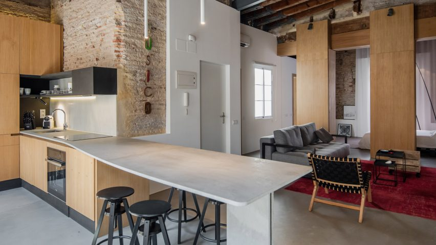 Wooden storage units create living spaces in once-derelict Valencia apartment