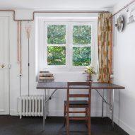 Copper pipes create storage solutions for Paris studio flat by Ariel Claudet
