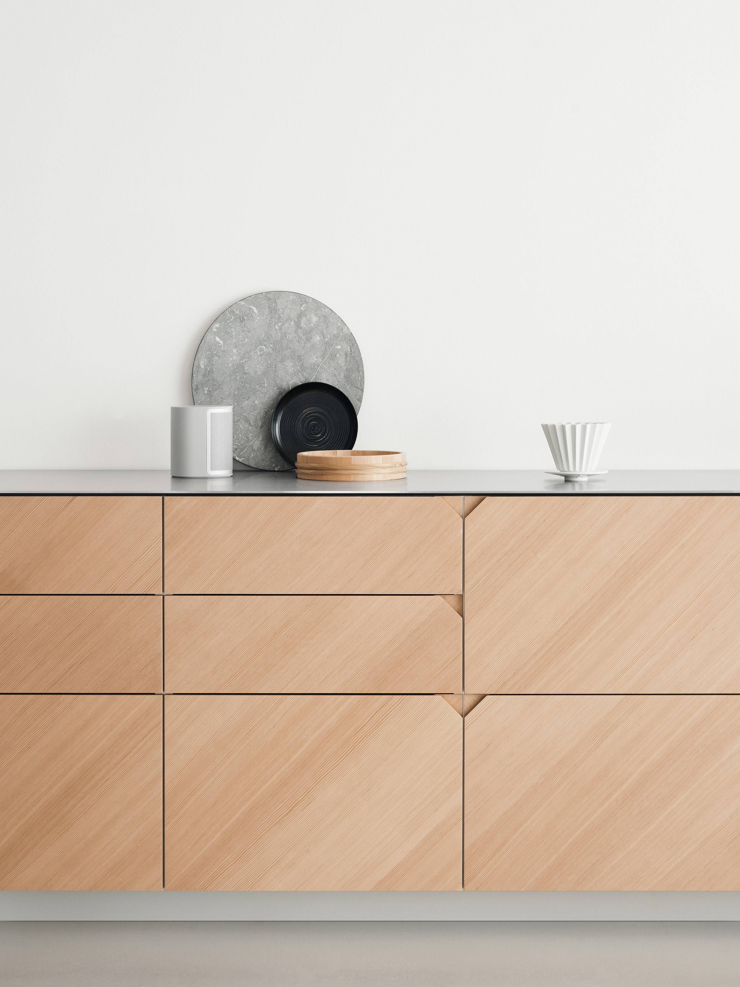 Cecilie Manz hacks IKEA kitchen using steel and warm-toned wood
