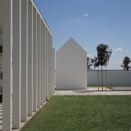 Gabled tombs sit within serene courtyards at Italian cemetery