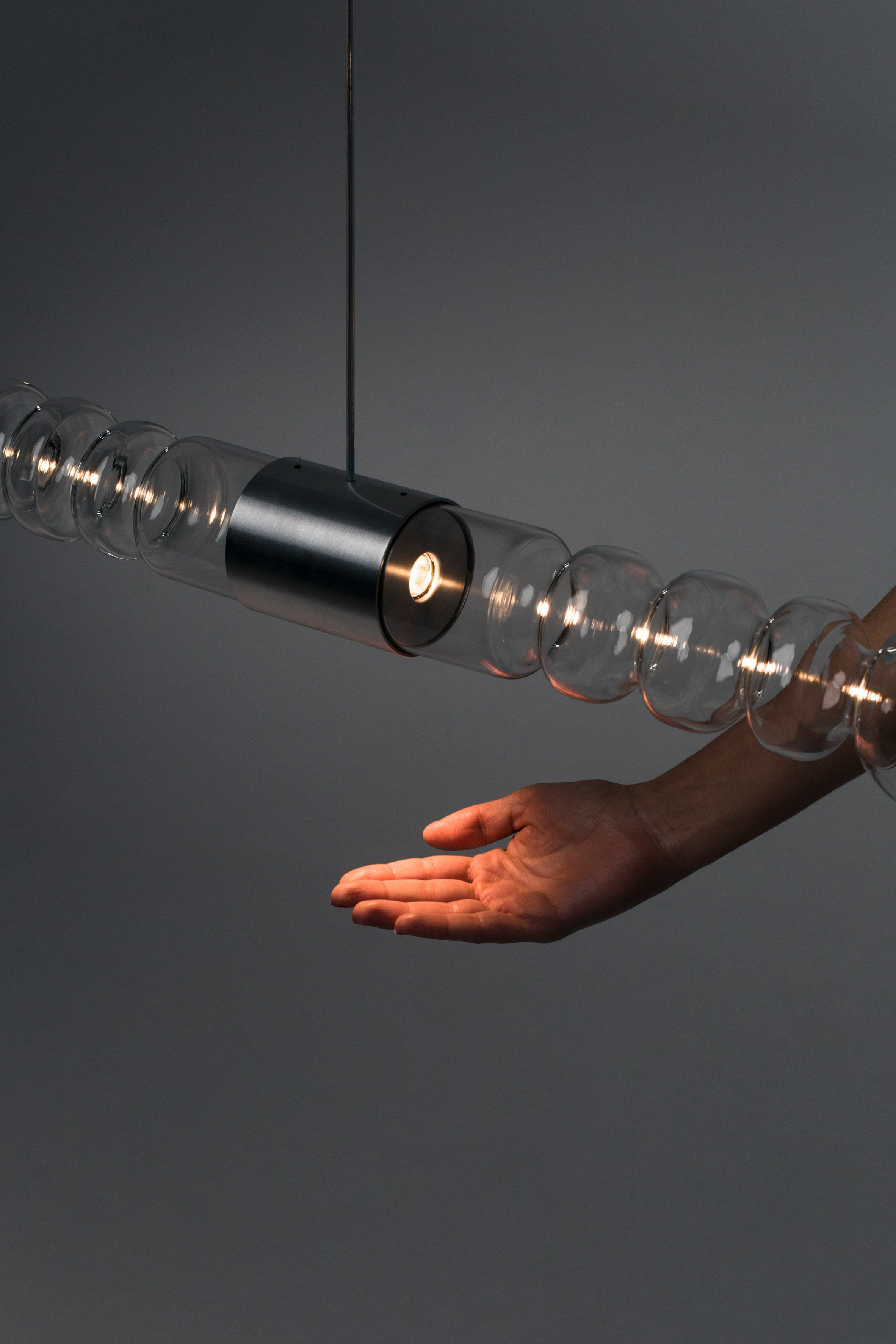 Mayice Studio creates sculptural lamp from curving glass tube