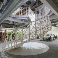 Sweeping staircase forms centrepiece of engineering office by Studio Ben Allen
