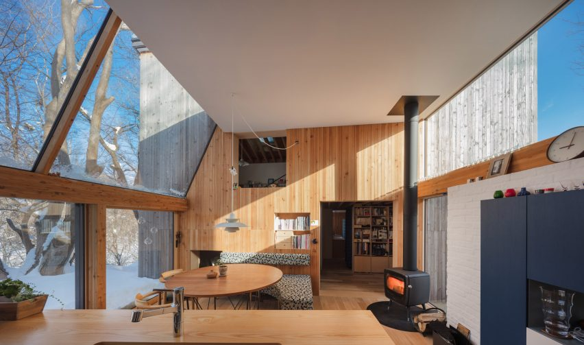 Timber volumes form livework spaces for artist and architect in