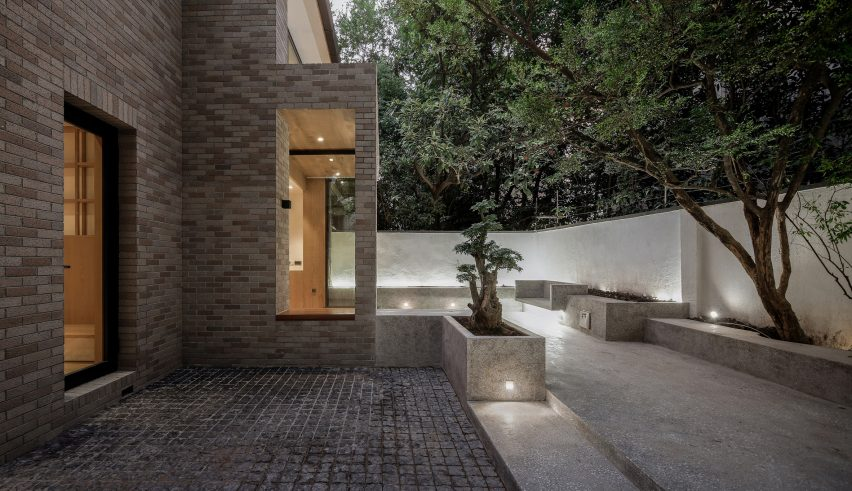 The House With A Tiny Patio by Atelier Tao+C