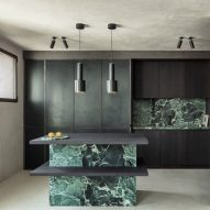 Arjaan de Feyter uses moody material palette for Belgian lawyers office