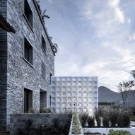 3D-printed pavilion contrasts with traditional stone structure at LEI House by AZL Architects